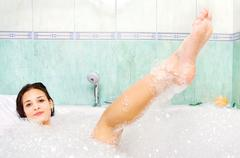 woman enjoy bath foam in bathtub - stock photo