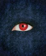 Red eye over blue texture Stock Photos