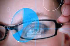 Woman wearing glasses with blue identification technology Stock Photos