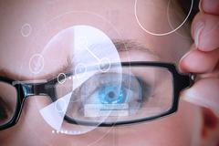 Womans eye being scanned for authorization Stock Photos