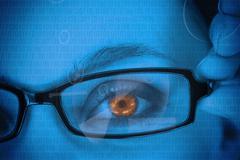 Woman with orange eye wearing glasses - stock photo