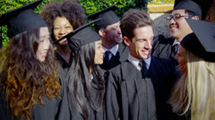 Portrait of a happy multi-ethnic group of friends together on graduation day Stock Footage