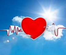 Heart rate waveform with big red heart - stock photo