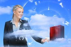 Businesswoman touching data server tower - stock photo