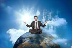 Businessman sitting on top of the world Stock Photos
