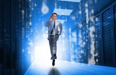 Businessman running through data center - stock photo