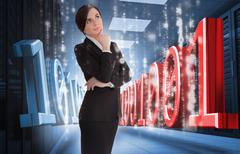 Businesswoman thinking of binary code in data center - stock photo