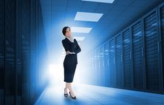 Businesswoman standing in data center - stock photo