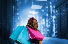 Girl with shopping bags looking at falling matrix - stock photo
