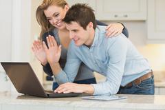 Couple chatting via webcam - stock photo