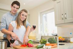 Stock Photo of Couple cooking and drinking wine