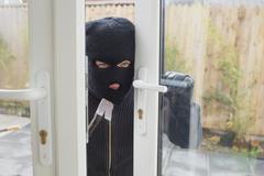 Burglar opening the door - stock photo