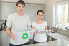 Couple recycling - stock photo