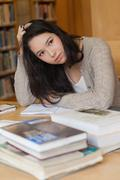 Stock Photo of Stressed student in a library