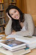 Smiling student in library Stock Photos