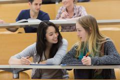 Talking students in a lecture hall Stock Photos