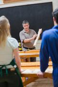 Stock Photo of Explaining teacher and the woodwork class