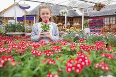 Child holding flower pot Stock Photos
