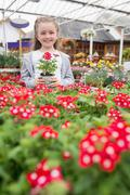 Child holding a flower pot - stock photo