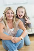 Little girl about to scare her mother Stock Photos