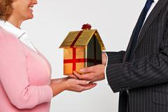 a woman receiving a new home - stock photo
