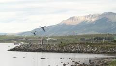 People walking along patagonian harbour Stock Footage