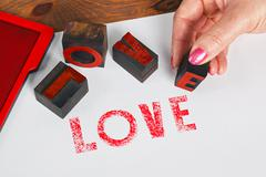 the word love using wooden letterpress - stock photo