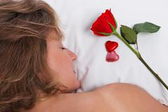 Stock Photo of woman asleep on valentines day