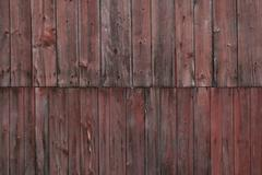 the side of a weathered barn. - stock photo