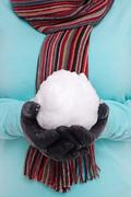 woman holding a snowball. - stock photo