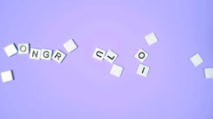 Stock Video Footage of Plastic letters bouncing and spelling out congratulations