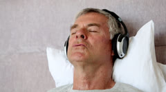 Man moving his head while listening to music Stock Footage