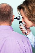 ear examination - stock photo