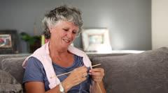 Mature woman knitting Stock Footage
