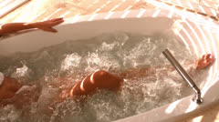 Laid down attractive woman in a jacuzzi Stock Footage