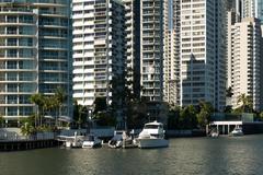 Apartment buildings on waterway Stock Photos