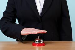 Woman ringing a reception bell Stock Photos