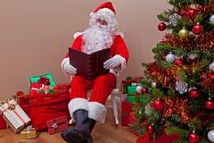Santa claus reading the list Stock Photos