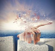 Dancer paints the sky suring sunset Stock Photos