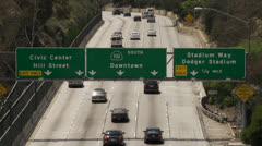 Freeway signs above traffic Stock Footage