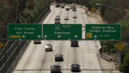 Stock Video Footage of Freeway signs above traffic