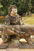 statue of garuda holding naga, preah khan temple - stock photo