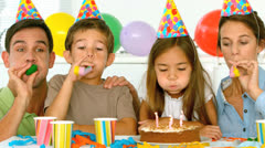 Happy family celebrating their daughter birthday Stock Footage