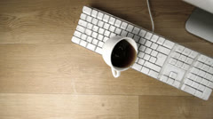 Cup of tea spilled out over a white keyboard Stock Footage