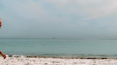 Sportswoman jogging on the beach Stock Footage