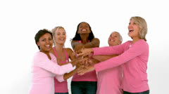 Group of cheerful women raising arms for breast cancer awareness Stock Footage