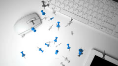 Group of pushpins falling on office desk Stock Footage