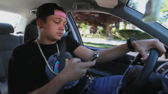 Stock Video Footage of TEEN TEXTING WHILE DRIVING