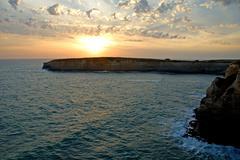coastline sunset - stock photo