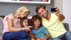 Father taking self portrait of him with smiling family Stock Footage